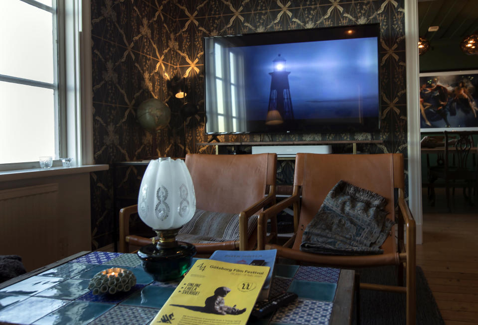 "The living room inside a cabin which will act as a screening room, on the island of Hamneskar, western Sweden on Saturday, Jan. 30, 2021. The 44th Goteborg film festival opened this weekend in a mostly virtual format but an emergency ward nurse from Sweden was selected among 12,000 volunteers to spend a week on an isolated island in the North Sea with for only companionship the events' entire movie selection. Lisa Enroth said the opportunity gave her ""time to reflect"" after a busy year amid the COVID pandemic. (AP Photo/Thomas Johansson)"