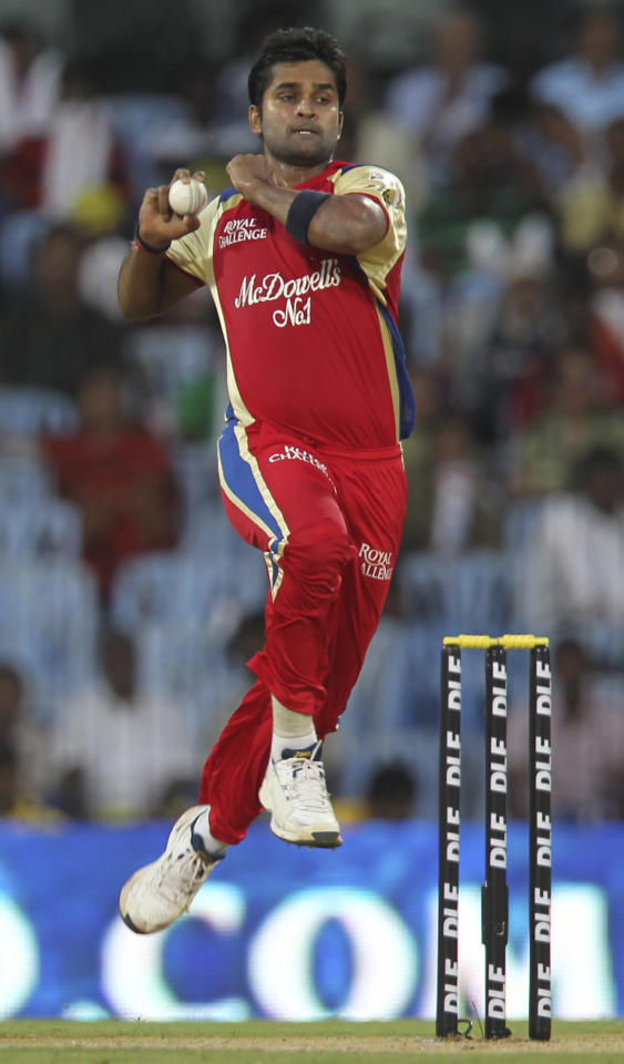 Royal Challengers Bangalore cricketer Vinay Kumar bowls during the IPL Twenty20 cricket match between Chennai Super Kings and Royal Challengers Bangalore at The M.A. Chidambaram Stadium in Chennai on April 12, 2012.  RESTRICTED TO EDITORIAL USE. MOBILE USE WITHIN NEWS PACKAGE    AFP PHOTO/Seshadri SUKUMAR (Photo credit should read SESHADRI SUKUMAR/AFP/Getty Images)