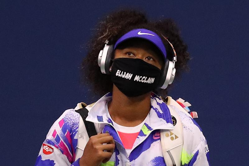 NEW YORK, NEW YORK - SEPTEMBER 02: Naomi Osaka of Japan walks in wearing a mask with the name Elijah McClain on it before her Women's Singles second round match against Camila Giorgi of Italy on Day Three of the 2020 US Open at the USTA Billie Jean King National Tennis Center on September 2, 2020 in the Queens borough of New York City. McClain was shot and killed by police on Aurora, Colorado August 24, 2020. (Photo by Matthew Stockman/Getty Images)