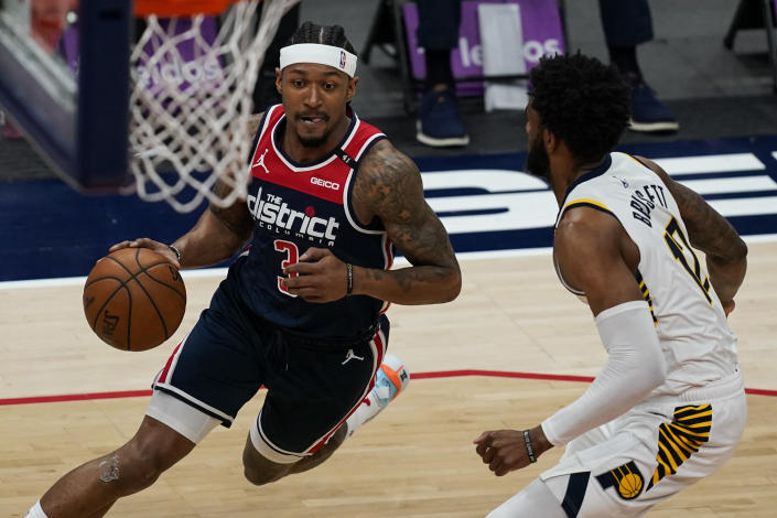 Washington Wizards guard Bradley Beal (3) drives against Indiana Pacers forward Oshae Brissett (12) during the first half of a basketball game, Monday, May 3, 2021, in Washington. (AP Photo/Alex Brandon)
