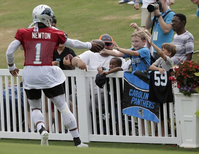 Cam Newton and the Carolina Panthers are one of 12 NFL teams that still hold training camp away from their team facility. The Panthers have camp at Wofford College. (AP)