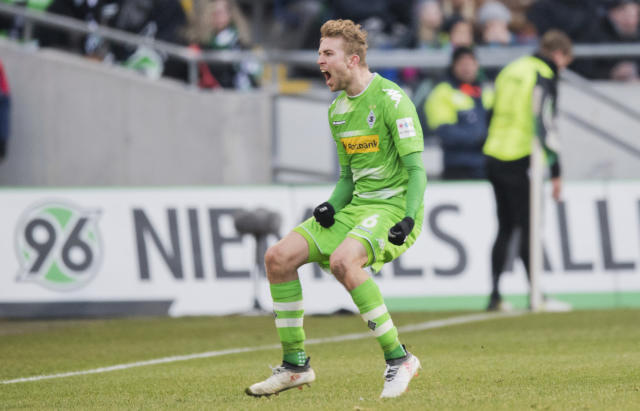 Gladbach's Christoph Kramer celebrates after scoring during the German Bundesliga soccer match between Hannover 96 and Borussia Moenchengladbach in Hannover, northern Germany, Saturday, Feb. 24, 2018. (Julian Stratenschulte/dpa via AP)