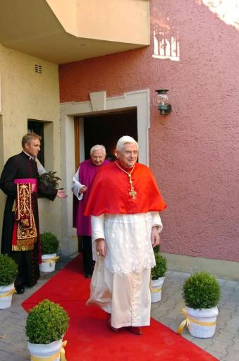 German Archbishop Georg Gaenswein (L) is seen occupying a crucial role for ex-pope Joseph Ratzinger (R)