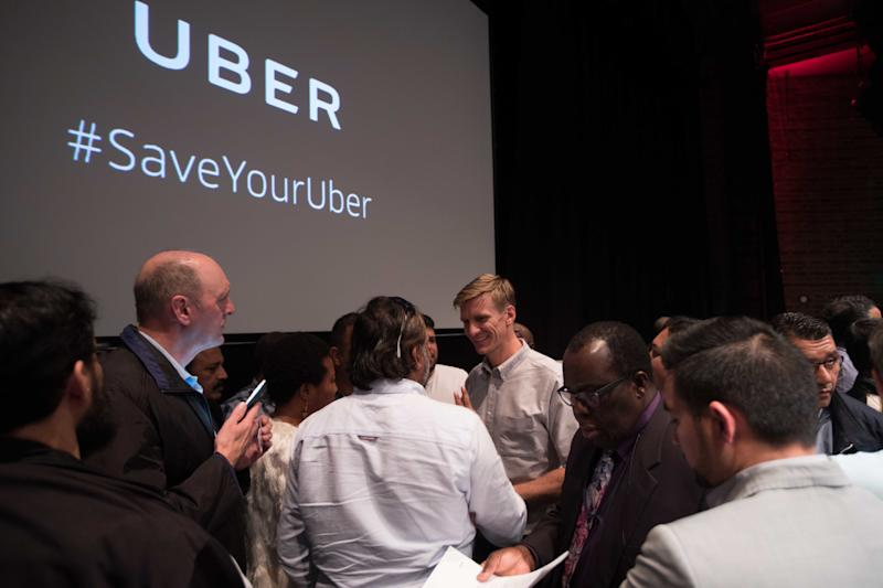 EDITORIAL USE ONLY Tom Elvidge, General Manager of Uber in London, answers questions at an event in central London for Uber drivers following TfL's decision to not renew the taxi appÕs licence in London.