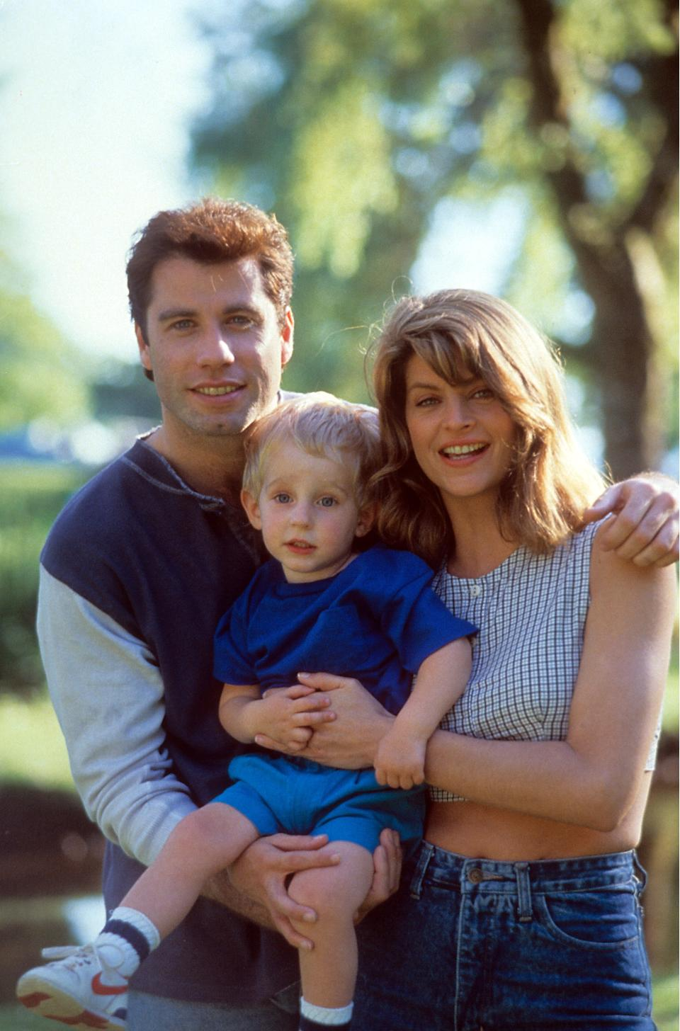 John Travolta and Kirstie Alley holding a child in a scene from the film 'Look Who's Talking', 1989. (Photo by TriStar Pictures/Getty Images)