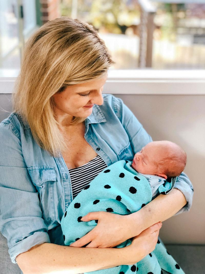 Sarah Mill pictured with baby son Oliver. [Photo: Caters]