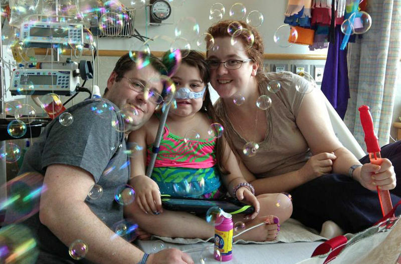 In this May 30, 2013 photo provided by the Murnaghan family, Sarah Murnaghan, center, celebrates the 100th day of her stay in Children's Hospital of Philadelphia with her father Fran, left, and mother Janet. The 10-year-old suburban Philadelphia girl has been hospitalized at Children's Hospital of Philadelphia for three months with end-stage cystic fibrosis. Her family wants an exception made for Sarah to get an adult lung, because so few pediatric lungs become available. Kathleen Sebelius, U.S. Secretary of Health and Human Services, says she doesn't want to intervene in transplant decisions when other children are just as sick. Sarah's relatives say they want the policy changed for all children awaiting a lung transplant, not just Sarah. (AP Photo/Murnaghan family)