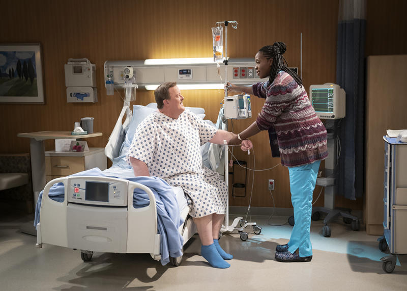 Bob, a middle-aged compression-sock businessman from Detroit, unexpectedly falls for his cardiac nurse, Abishola, a Nigerian immigrant, while recovering from a heart attack and sets his sights on winning her over, on the series premiere of Bob Hearts Abishola. (Photo: Sonja Flemming/CBS)