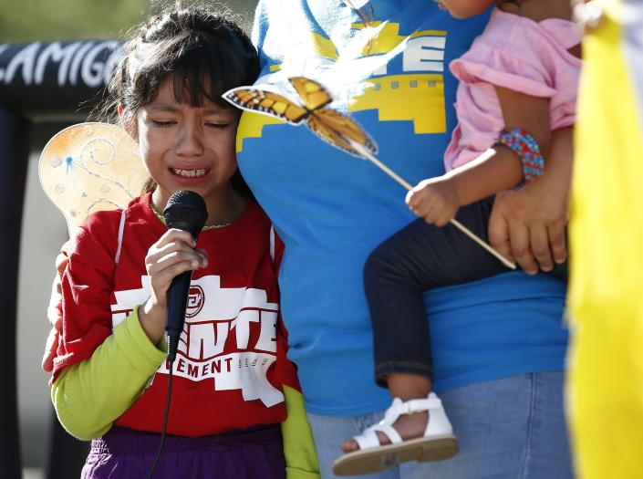 <p>Akemi Vargas, 8, cries as she talks about being separated from her father during an immigration family separation protest in front of the Sandra Day O'Connor U.S. District Court building, Monday, June 18, 2018, in Phoenix, Ariz. (Photo: Ross D. Franklin/AP) </p>