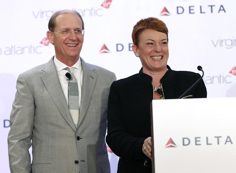 Delta Airlines CEO Richard Anderson and Virgin Atlantic CCO Julie Southern laugh during a news conference in New York, Tuesday, Dec. 11, 2012. Delta Air Lines said it will buy almost half of Virgin Atlantic for $360 million as it tries to catch up to rivals in the lucrative New York-to-London travel market. (AP Photo/Seth Wenig)