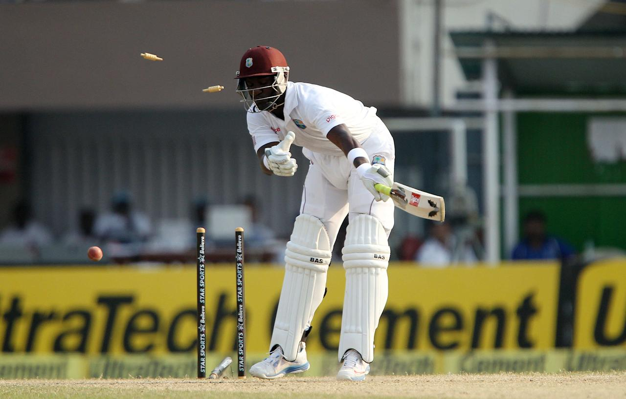 Darren Sammy captain of West Indies is bowled by Mohammed Shami during day three of the first Star Sports test match between India and The West Indies held at The Eden Gardens Stadium in Kolkata, India on the 8th November 2013  Photo by: Ron Gaunt - BCCI - SPORTZPICS