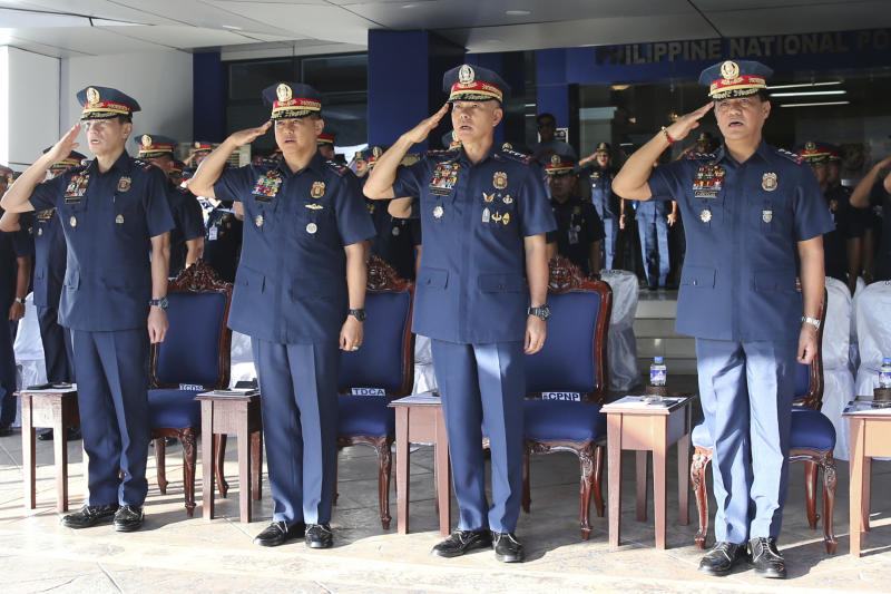 In this photo provided by Philippine National Police Public Information Office, Philippine National Police chief Gen. Oscar Albayalde, second from right, along with top police generals, Lt.Gen. Camilo Cascolan, right, Lt.Gen. Archie Gamboa, second from left, and Maj.Gen. Guillermo Eleazar, left, salutes during the flag-raising ceremony at Camp Crame Monday, Oct. 14, 2019 in suburban Quezon city, northeast of Manila, Philippines. Albayalde resigned on Monday after he faced allegations in a Senate hearing that he intervened as a provincial police chief in 2013 to prevent his officers from being prosecuted for allegedly selling a huge quantity of illegal drugs they had seized. (Philippine National Police Via AP)