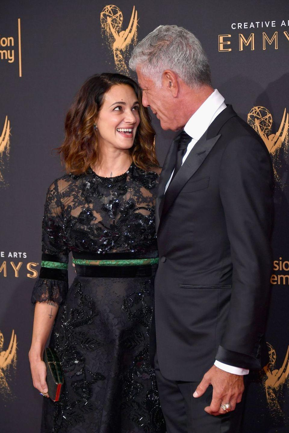 """<p>Bourdain <a href=""""https://www.delish.com/restaurants/g19500653/anthony-bourdain-girlfriend"""" rel=""""nofollow noopener"""" target=""""_blank"""" data-ylk=""""slk:began dating actress and director Asia Argento"""" class=""""link rapid-noclick-resp"""">began dating actress and director Asia Argento</a> in early 2017. In an interview with <a href=""""https://people.com/food/anthony-bourdain-responsibility-to-live-for-daughter-people-interview/"""" rel=""""nofollow noopener"""" target=""""_blank"""" data-ylk=""""slk:PEOPLE"""" class=""""link rapid-noclick-resp"""">PEOPLE</a> earlier this year, Bourdain said he was """"happy in ways that I have not been in memory,"""" and """"happy in ways I didn't think I ever would be, for sure,"""" in reference to Argento.</p>"""