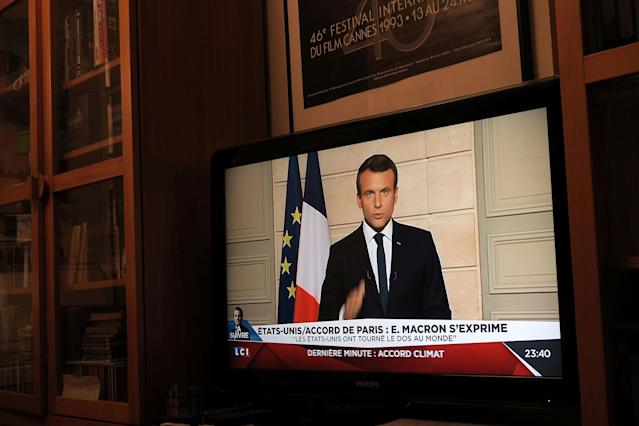 <p>French President Emmanuel Macron, seen on all news channel LCI, speaks from the Elysee Palace in Paris, France, after President Donald Trump announced his decision that the United States will withdraw from the Paris Climate Agreement at a news conference, June 1, 2017. (John Schults/Reuters) </p>