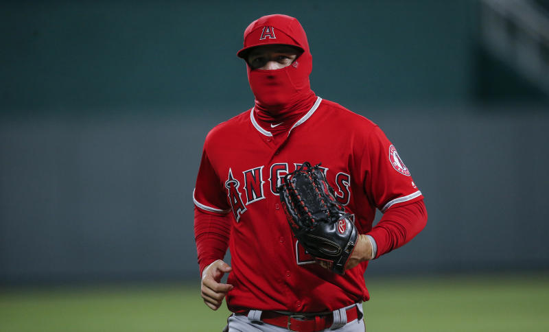 KANSAS CITY, MISSOURI - APRIL 27: Mike Trout #27 of the Los Angeles Angels of Anaheim runs in from centerfield on a cold night in the seventh inning during the game against the Kansas City Royals at Kauffman Stadium on April 27, 2019 in Kansas City, Missouri. (Photo by John Sleezer/Getty Images)