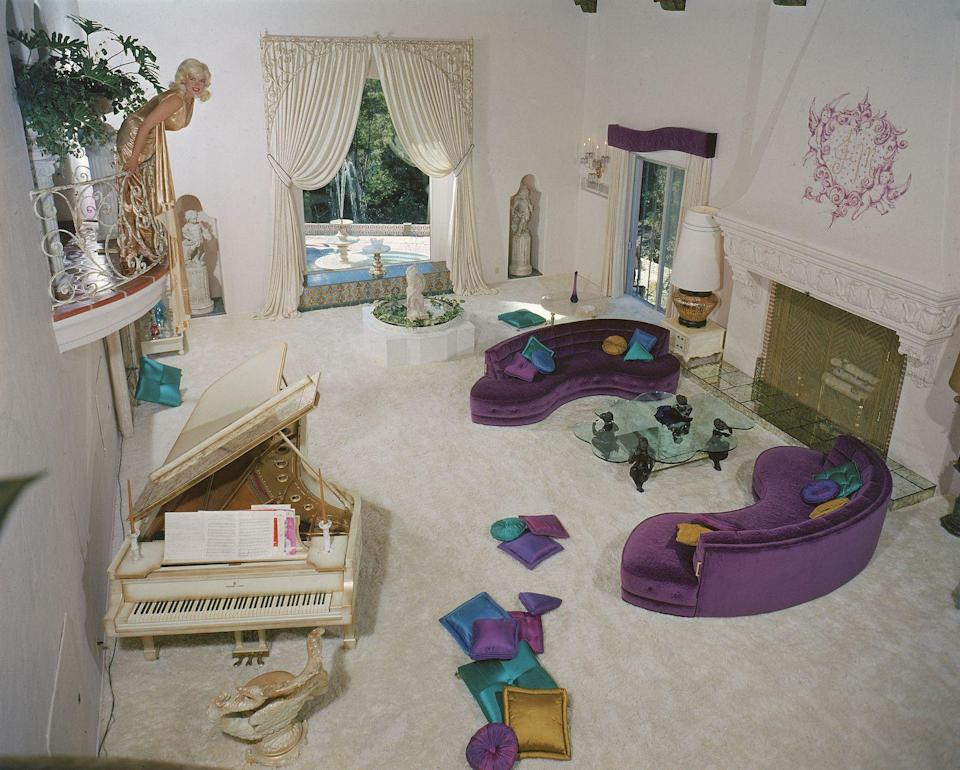 """<p>The couple settled into a Beverly Hills mansion that they dubbed """"the Pink Palace,"""" complete with a heart-shaped pool. </p>"""