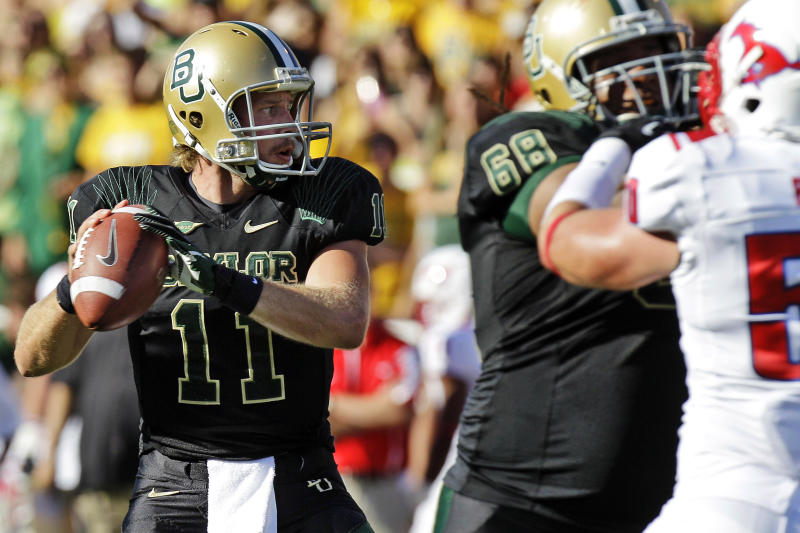 Baylor quarterback Nick Florence (11) passes as offensive tackle Cyril Richardson (68) blocks Southern Methodist linebacker Cameron Rogers (50) during the first half of an NCAA college football game in Waco, Texas, Sunday, Sept. 2, 2012. (AP Photo/LM Otero)