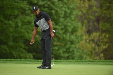 May 17, 2019; Bethpage, NY, USA; Tiger Woods reacts to his putt on the 14th hole during the second round of the PGA Championship golf tournament at Bethpage State Park - Black Course. Mandatory Credit: John David Mercer-USA TODAY Sports