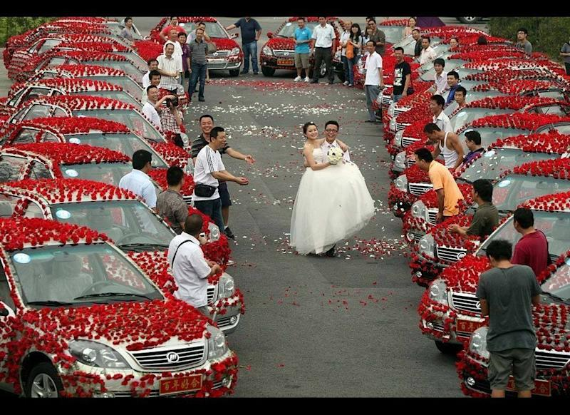 Love Blossoms: Talk about love in bloom. On Aug. 15, 2010, groom Xiao Wang and his bride Xiao Liu were married in Chongqing, China, surrounded by 99,999 red roses. Wang spent an entire year's salary on the flowers, which had to be transported to the wedding ceremony by a fleet of 30 cars, all adorned with the blossoms. In China, the number 999 is considered good luck, so here's to hoping their union continues to grow.