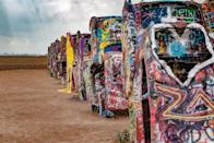 "<p>This iconic art instillation was <a href=""https://www.atlasobscura.com/places/cadillac-ranch"" rel=""nofollow noopener"" target=""_blank"" data-ylk=""slk:created in 1974"" class=""link rapid-noclick-resp"">created in 1974</a>, and features 10 Cadillacs that appear to be growing out of the ground. They've been covered in graffiti by visitors and if you bring your own paint, you are allowed to leave your mark on this free monument. </p>"