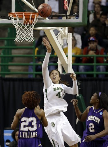 Baylor's Brittney Griner (42) shoots against Prairie View A&M's Latia Williams (23) and Shamiya Brooks, right, in the first half of a first-round game in the women's NCAA college basketball tournament, Sunday, March 24, 2013, in Waco, Texas. (AP Photo/Tony Gutierrez)