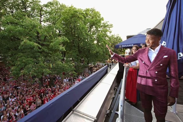 Bayern Munich's David Alaba celebrates winning the Bundesliga trophy at the Nockherberg beer garden in Munich, Germany, May 12, 2018. Picture taken May 12, 2018. Alexander Hassenstein/Pool via Reuters