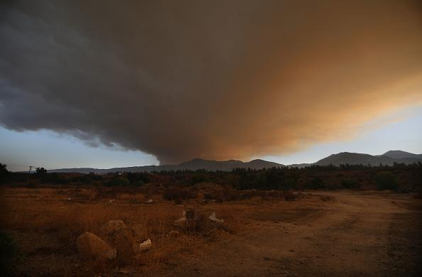 Smoke rises from the Holy Fire in Cleveland National Forest on August 6, 2018 in Temescal Valley, California. The fast moving brush fire has burned at least 4,000 acres. (Photo by Mario Tama/Getty Images,)