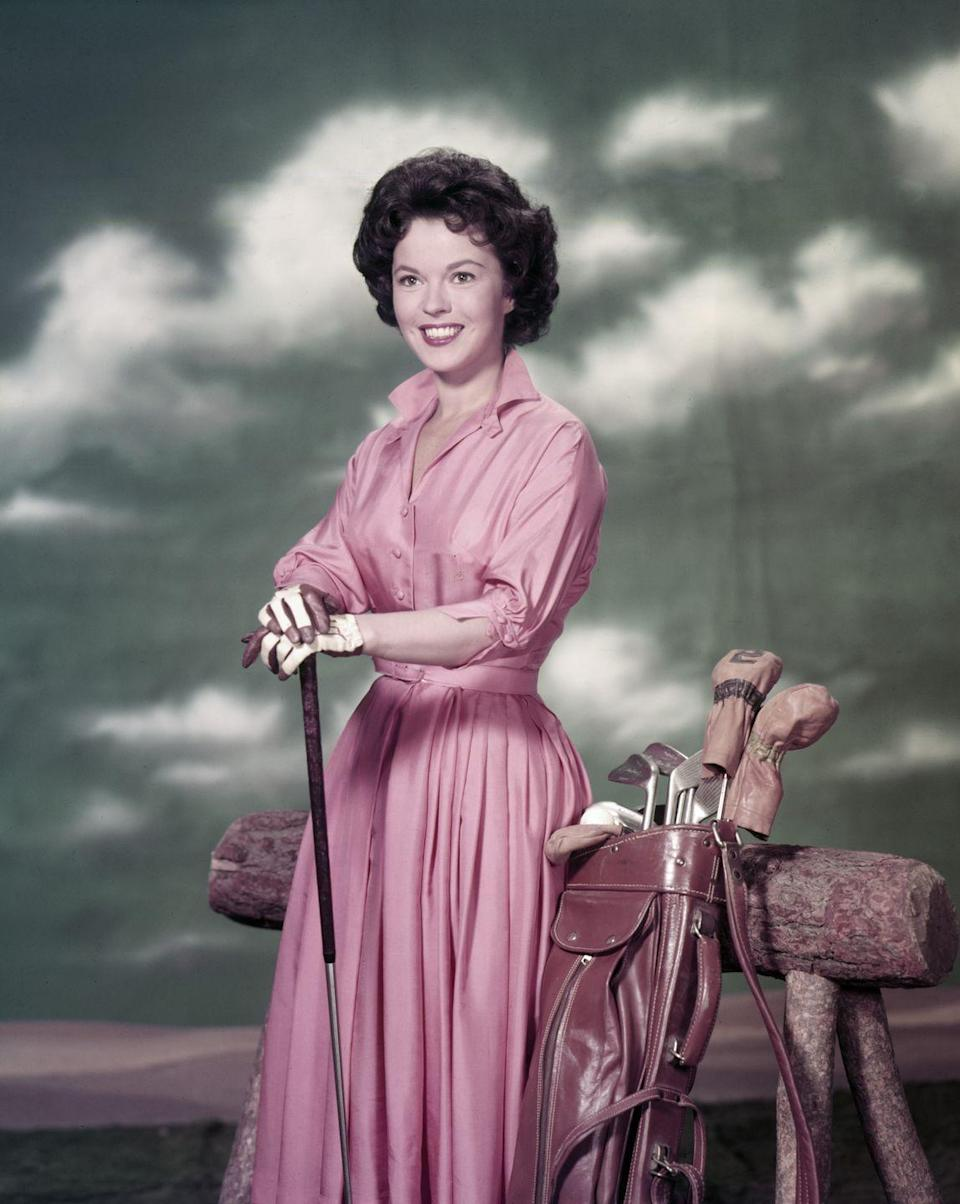 """<p>Shirley Temple posing in a promotional photo for """"Shirley Temple's Storybook"""" a children's anthology series that she hosted and narrated. </p>"""