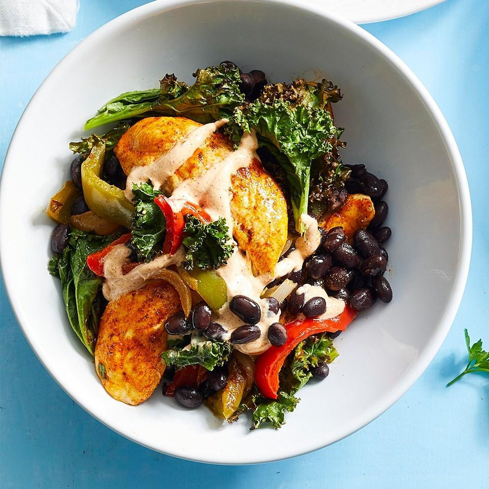 <p>Skip the tortillas in favor of this warm fajita salad, which features a nutritious medley of chicken with roasted kale, bell peppers and black beans. The chicken, beans and vegetables are all cooked on the same pan, so this healthy dinner is easy to make and the cleanup is easy too.</p>