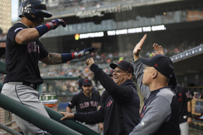 Cleveland Indians manager Terry Francona, center, congratulates Leonys Martin, left, after Martin hit a three-run home run against the Detroit Tigers in the top of the fourth inning of a baseball game, Friday, June 14, 2019, in Detroit. (AP Photo/Jose Juarez)
