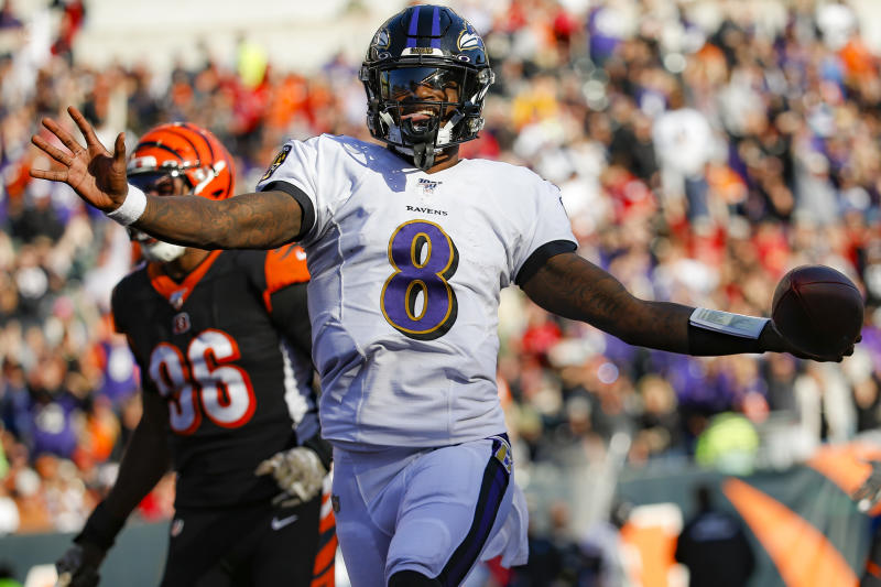 All hail: Baltimore Ravens coach John Harbaugh told quarterback Lamar Jackson that he's changing the game. (AP/Frank Victores)