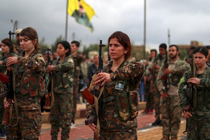 Fighters from the Kurdish Women's Protection Units (YPJ) attend the funeral of a comrade, killed in battle with the Islamic State group, in the northeastern Syrian city of Qamishli on February 9, 2019 (AFP Photo/Delil souleiman)
