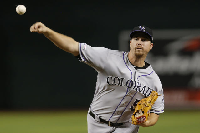 Colorado Rockies pitcher Chi Chi Gonzalez throws against the Arizona Diamondbacks in the first inning of a baseball game, Monday, Aug. 19, 2019, in Phoenix. (AP Photo/Rick Scuteri)