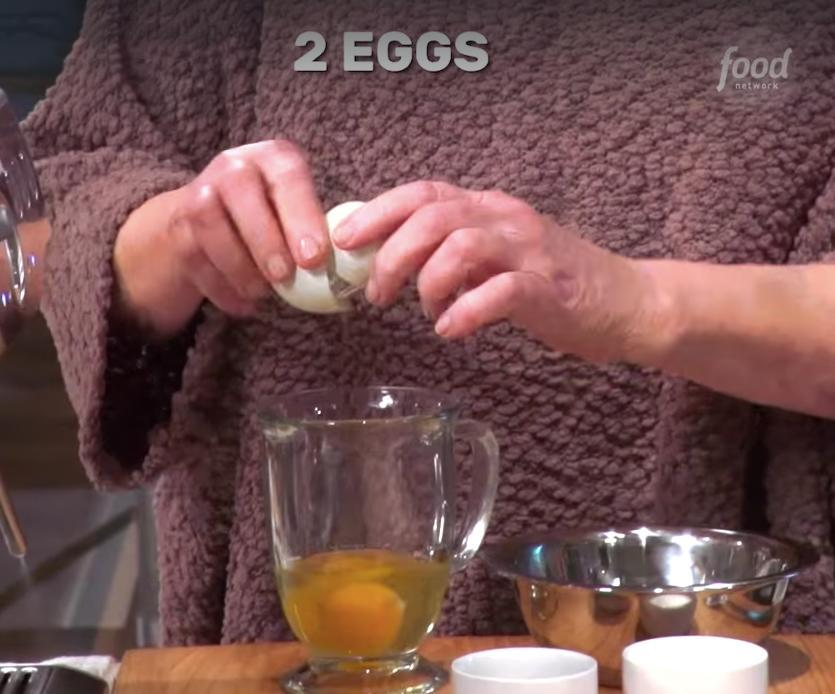 She prepares the eggs in a heatproof jug with salt, pepper and butter. Photo: Facebook/Food Network