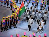 <p>Hands down, this might be the best Opening Ceremony outfit of the night. It ticked not one, not two, but <i>three</i> of fashion's favorite tropes: the stripes, the tunic shape, and the street style-worthy hat. And as a bonus, intricate prints and detailing. </p><p><i>(Photo: Getty Images)</i><br></p>