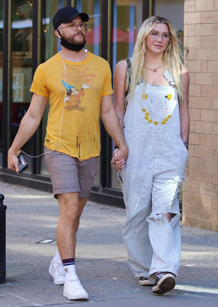 <p>Kesha holds hands with a mystery man while out in N.Y.C.'s Soho neighborhood on Sept. 7.</p>