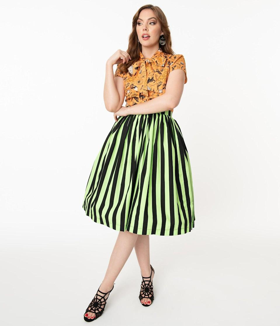 <p>You'll get all the attention in this <span>Neon Green and Black Striped Gathered Cotton Swing Skirt</span> ($58). </p>