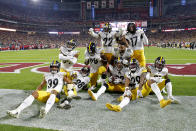 Pittsburgh Steelers cornerback Joe Haden (23) celebrates his game-ending interception against the Arizona Cardinals with teammates during the second half of an NFL football game, Sunday, Dec. 8, 2019, in Glendale, Ariz. The Steelers won 23-17. (AP Photo/Rick Scuteri)