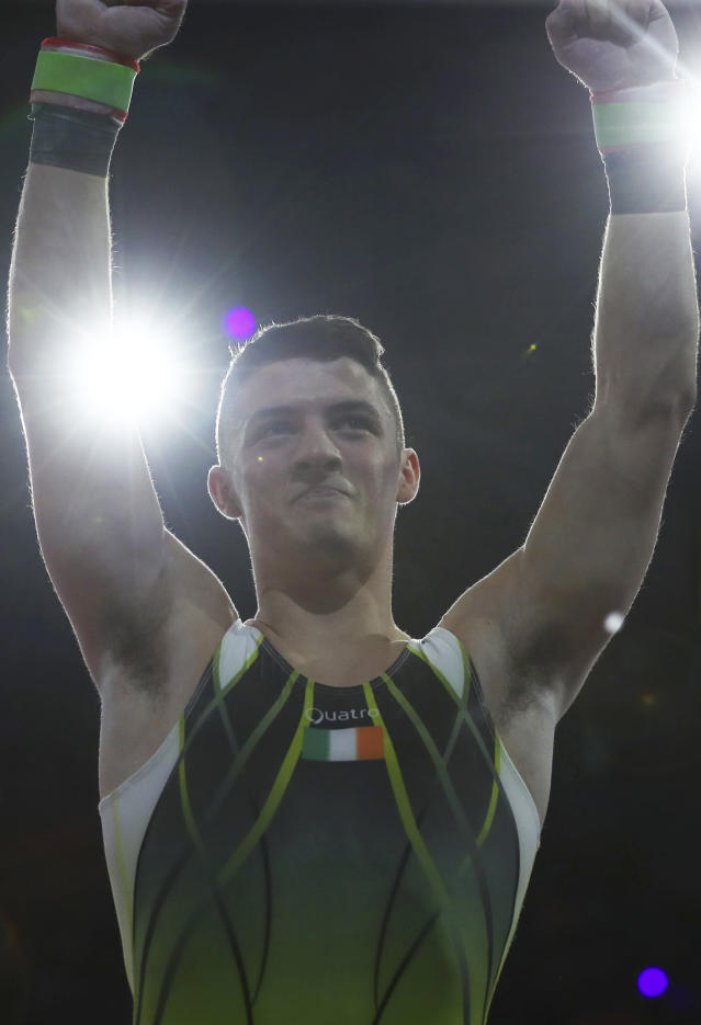 Bronze medalist Rhys McClenaghan of Ireland celebrates after his performance on the pommel horse in the men's apparatus finals at the Gymnastics World Championships in Stuttgart, Germany, Saturday, Oct. 12, 2019. (AP Photo/Matthias Schrader)