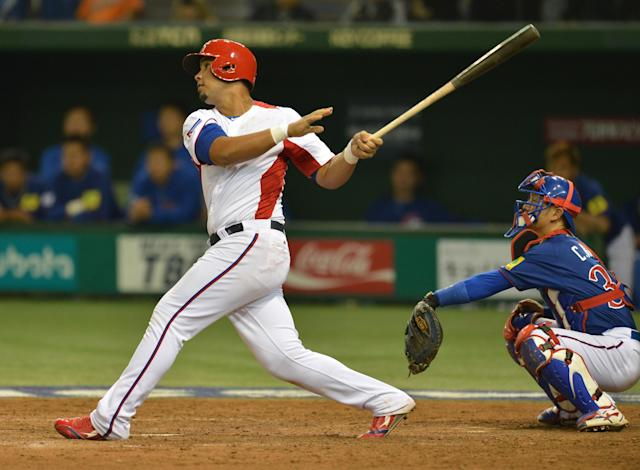 Cuba's infielder Jose Abreu (L) makes a two-run homer as Taiwan's catcher Kao Chih-Kang looks on during the sixth innings of their second-round Pool 1 game in the World Baseball Classic tournament at Tokyo Dome on March 9, 2013. AFP PHOTO / KAZUHIRO NOGIKAZUHIRO NOGI/AFP/Getty Images