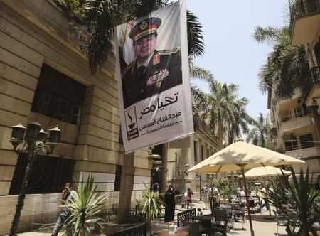 A poster of Abdel Fattah al-Sisi hangs outside the stock exchange in Cairo