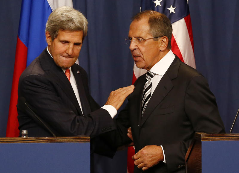 U.S. Secretary of State Kerry and Russian Foreign Minister Lavrov shake hands after making statements following meetings regarding Syria, at a news conference in Geneva