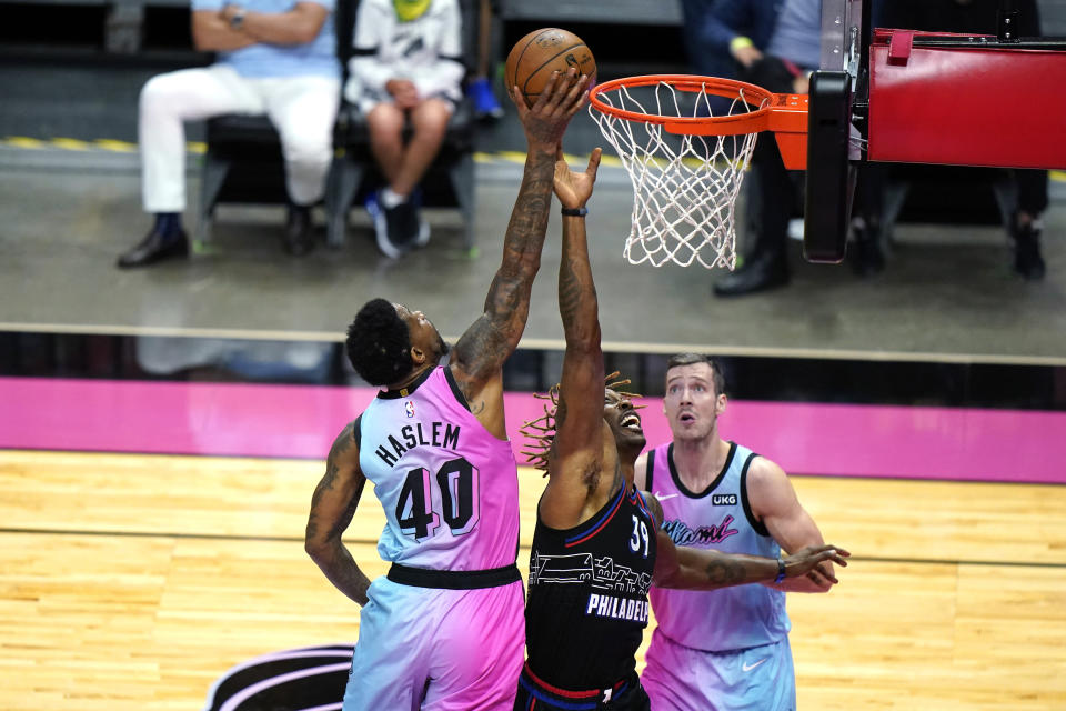 Miami Heat forward Udonis Haslem (40) vies for a rebound against Philadelphia 76ers center Dwight Howard (39) during the first half of an NBA basketball game Thursday, May 13, 2021, in Miami. (AP Photo/Lynne Sladky)
