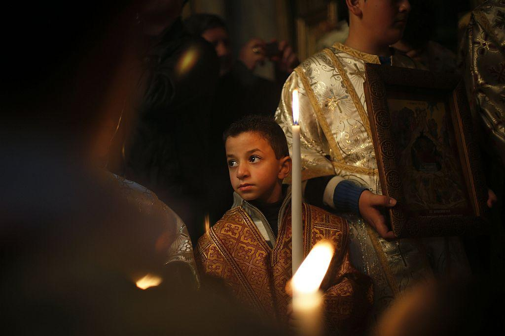 GAZA: A Palestinian Greek Orthodox boy attends Christmas services at the Saint Porfirios church in Gaza City January 7, 2013.
