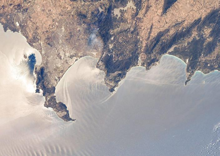 cape town jagged mountainous coast extends into silvery atlantic waters