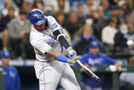Kansas City Royals' Salvador Perez connects for a grand slam against the Seattle Mariners in the fourth inning of a baseball game Friday, Aug. 27, 2021, in Seattle. (AP Photo/Elaine Thompson)