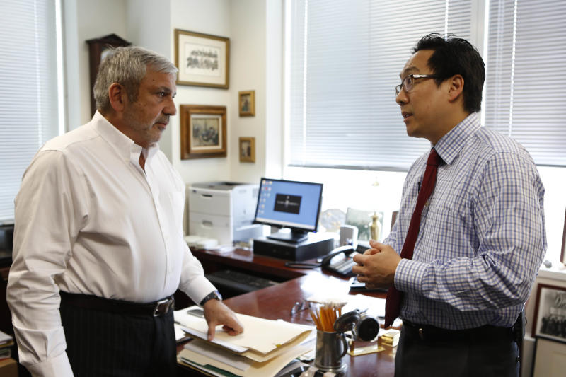 "In this May 6, 2013 photo provided by CBS, a scene form a CBS documentary entitled ""Brooklyn DA,"" shows Michael Vecchione, left, Chief of the Rackets Division, speaking with Lawrence Oh, Assistant District Attorney, Bureau Chief, Rackets Division, at the Office of the Kings County District Attorney in the Brooklyn Borough of New York. The documentary series featuring Brooklyn District Attorney Charles Hynes airs Tuesday, June 18, 2013, and gives viewers a look at how cases are prosecuted at one of the largest district attorney offices in the country. Hynes is running for office and his opponents say the timing of the show is unfair. (AP Photo/CBS, Craig Blankenhorn) MANDATORY CREDIT; NO ARCHIVE; NO SALES; NORTH AMERICAN USE ONLY"