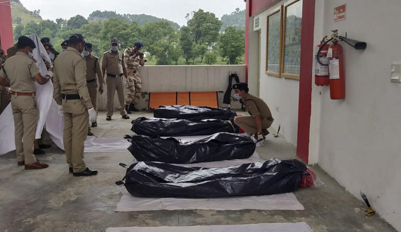 This photo released by Indo Tibetan Border Police (ITBP) shows some one among seven bodies believed to be from a missing team of international climbers after they were evacuated in helicopters from Himalayan mountain Nanda Devi and handed over to district authorities in Pithoragarh, northern India, Wednesday, July 3, 2019. Veteran British mountaineer Martin Moran led three other Britons, two Americans, an Australian and an Indian up Nanda Devi East. Contact was lost after a May 26 avalanche. (Indo Tibetan Border Police via AP)