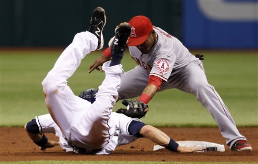 Los Angeles Angels shortstop Erick Aybar, right, tags out Tampa Bay Rays' Ben Zobrist at second base after Zobrist was picked off by Angels pitcher Jerome Williams during the first inning of a baseball game, Thursday, April 26, 2012, in St. Petersburg, Fla. (AP Photo/Chris O'Meara)