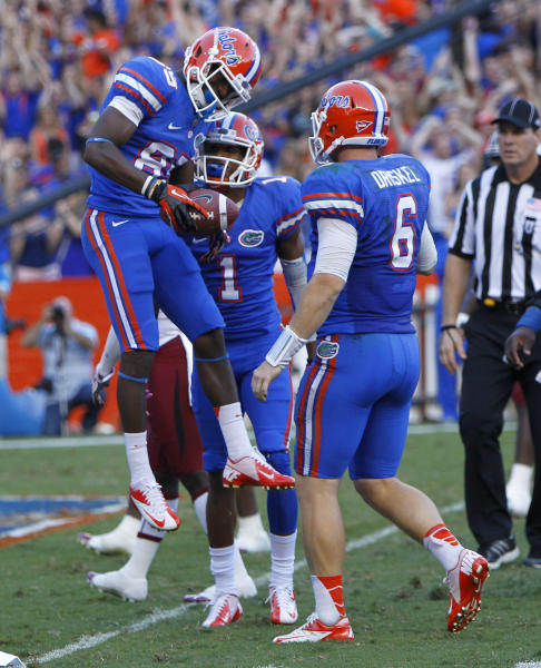 Florida's Frankie Hammond, Jr. (85) celebrates with Quinton Dunbar and Jeff Driskel (6) after making a touchdown catch during the second half of an NCAA college football game against South Carolina in Gainesville, Fla., Saturday, Oct. 20, 2012. (AP Photo/The Gainesville Sun, Brad McClenny) THE INDEPENDENT FLORIDA ALLIGATOR OUT